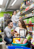 Customers at beverages section of supermarket Royalty Free Stock Photography