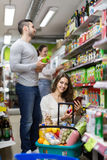 Customers at beverages section of supermarket Stock Image