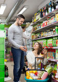 Customers at beverages section of supermarket Stock Photography
