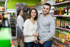 Customers at beverages section of supermarket Stock Images