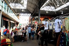 Customers browse stalls at Spitalfields Market London England Stock Images