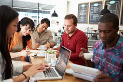 Customers In Busy Coffee Shop Stock Images