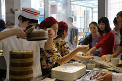 Customers buy chinese fast food in the arluohai town square. Customer buy chinese fast food in the restaurant of aluohai town square , amoy city, china royalty free stock photos