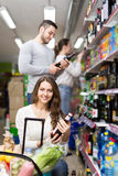 Customers buying alcohol in shop Royalty Free Stock Image