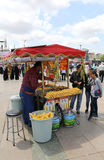 Customers buying boiled corn from a corn vendor at Eminonu Stock Photo