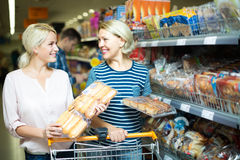 Customers buying bread in food shop Royalty Free Stock Image