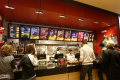 Customers buying fast food. Customers are buying fast food products inside a KFC (Kentucky Fried Chicken) restaurant Royalty Free Stock Photography