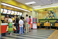 Customers buying fast food. Busy fast food restaurant in the wuxi city china,Aug 28, 2011. Customers are buying fast food products inside a KFC Stock Image