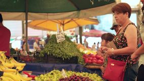 Customers buying fresh pears from seller at the biggest and most crowded bazaar in the city. Located in Bostanl stock footage