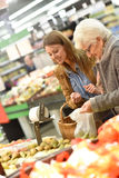 Customers buying groceries Royalty Free Stock Image