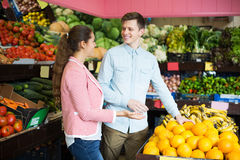 Customers buying oranges Stock Images