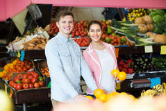 Customers buying oranges Stock Photography