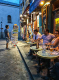 Customers at cafe tables on a Montmartre evening, Paris, France Stock Images