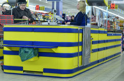 Customers at the cash register in the supermarket Stock Photography