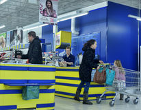 Customers at the cash register in the supermarket Stock Image