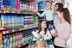 Customers with children selecting dairy products Stock Photo