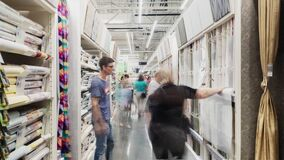 Customers choose new wallpapers in hardware supermarket hall