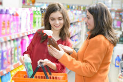 Customers choosing cleaning products in supermarket Stock Photography