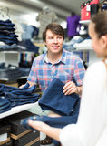 Customers choosing jeans in shop Stock Photo