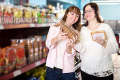Customers choosing pastry in food store Royalty Free Stock Photography