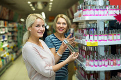 Customers choosing perfume Royalty Free Stock Photography