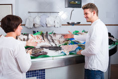 Customers choosing seafood Stock Images
