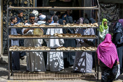 Customers crowd around the entrance to a bakery in Edfu in Egypt. Royalty Free Stock Photos