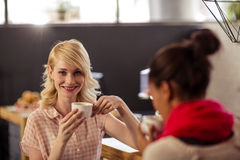 Customers drinking a coffee. In the bar royalty free stock photos