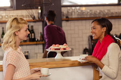 Customers drinking a coffee with the bartender Royalty Free Stock Photography
