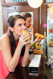 Customers eating Hotdog in fast food snack bar Stock Photo
