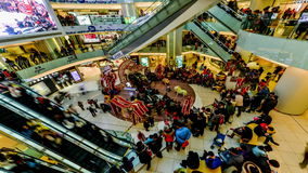 The customers enjoy the lion dance besides shopping during holiday in Beijing Stock Photo