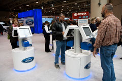 Customers entering information on Ford terminals. At the 2010 Canadian International Auto Show, Toronto, Canada Royalty Free Stock Photo