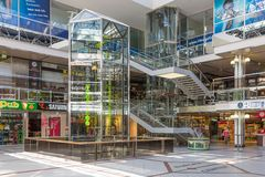 Customers in Europa Centre with a water clockwork in Berlin, Germany. BERLIN, GERMANY - JUL 21: Customers in a Shopping-centre with a water clockwork from 13 Stock Photo