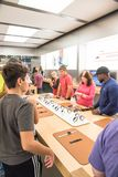 Customers experience Apple Watch Series 3 on the first day at store. HOUSTON, US-SEPT 22, 2017:Customers experience first impressions of Apple Watch Series 3 at Stock Photos