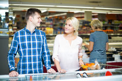 Customers at frozen food section Royalty Free Stock Photo