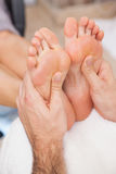 Customers getting both feet massaged Stock Photography