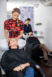Customers Getting Hair Washed In Beauty Salon Royalty Free Stock Image