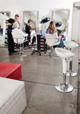 Customers And Hairstylist In Salon Stock Photos