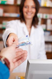 Customers Hand Passing Money To Female Pharmacist Stock Images