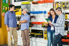 Customers In Hardware Store. Male and female customers in hardware store Stock Photos