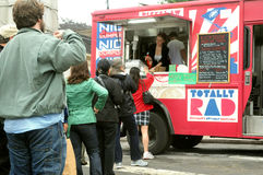 Customers line up at a food truck