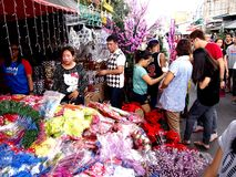 Customers look at a wide variety of chirstmas decors at a store in Dapitan Market Stock Photo