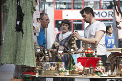 Customers looking at antiques at a stall in Brick Lane, Whitecha Stock Photography