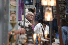 Customers looking at antiques at a stall in Brick Lane, Whitecha Royalty Free Stock Images