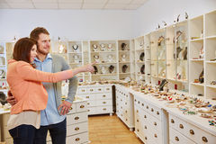Customers looking at jewelry store Royalty Free Stock Images