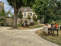 Customers lounging at the garden cafe tables at Montmartre Museum Stock Photo