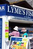 Customers at Lyme Regis Fish Shop. royalty free stock photography