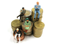 Customers with money to spend. Some potential customers sitting on piles of coins royalty free stock image