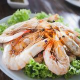 The customers ordered shrimp to burn salt during the trip to the beach in famous restaurants Stock Image