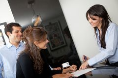Customers paying at the hotel Stock Image